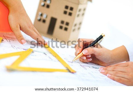 Architect makes changes to the documentation on the construction - stock photo