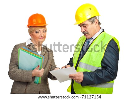 Architect man showing something on papers to his colleague woman and having conversation isolated on white background
