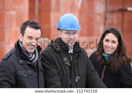 Architect meeting with new property owners - stock photo