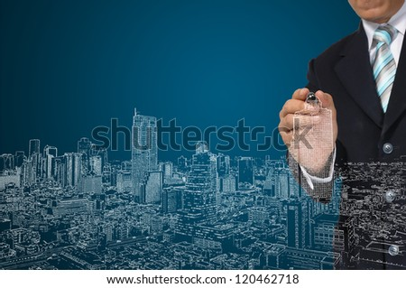 Architect or Business Man draw cityscape - stock photo