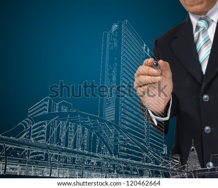 Architect or Business Man drawing cityscape - stock photo