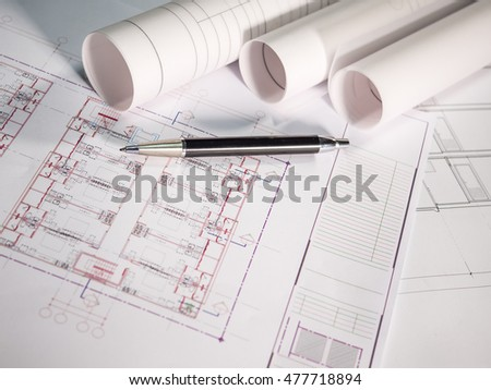 Architect plan rolls and pen on the table with Selective focus