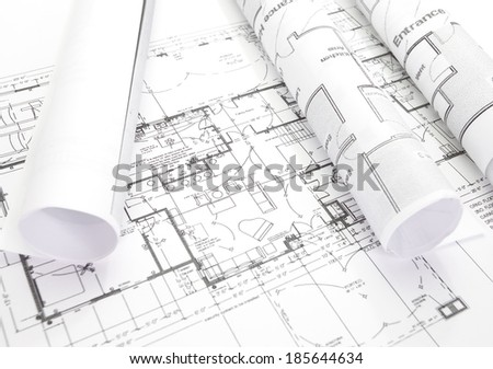 Architect rolls and plans architectural plan   - stock photo