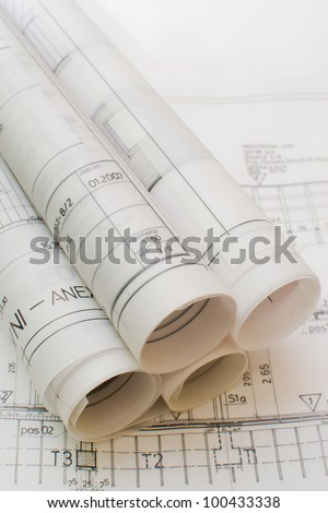 Architect rolls and plans.architectural plan,technical project drawing,Architecture planning of interiors design on paper,construction plan ,close up on constructions blueprints,architectural desk - stock photo