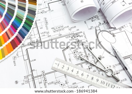 Architect's and designer's work space during work with technical drawing and color samples catalog - stock photo