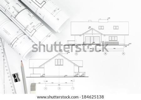 Architect's work table with technical drawings and work tools - stock photo