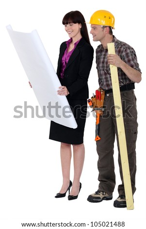 Architect showing off plans - stock photo