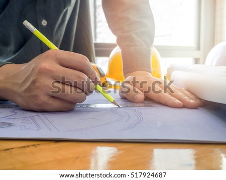 Architect sketching a construction project blueprint, architectural concept