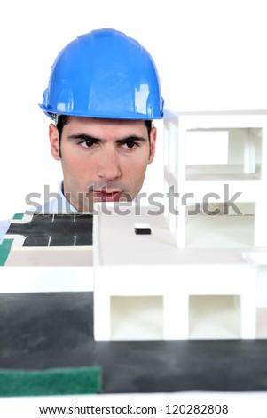 Architect studying a model - stock photo