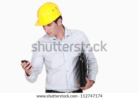 Architect with a briefcase and phone - stock photo