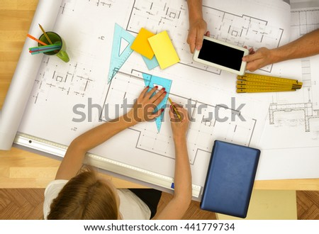 Architect with a project for a new house - stock photo
