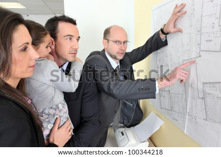Architect with a young family - stock photo