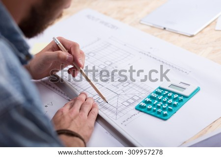 Cost estimate stock images royalty free images vectors architect with blueprint and calculator estimating project cost malvernweather Gallery