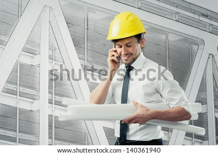 Architect with blueprint and cellphone - stock photo