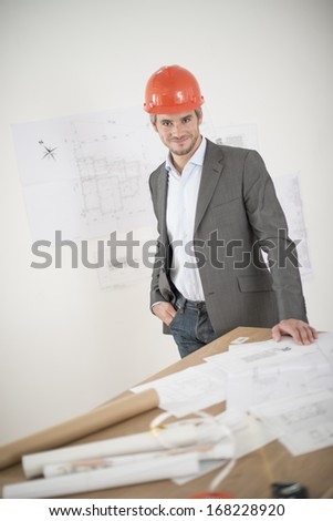 architect with hardhat on a construction site - stock photo
