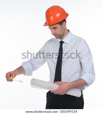 Architect with helmet and tape measure
