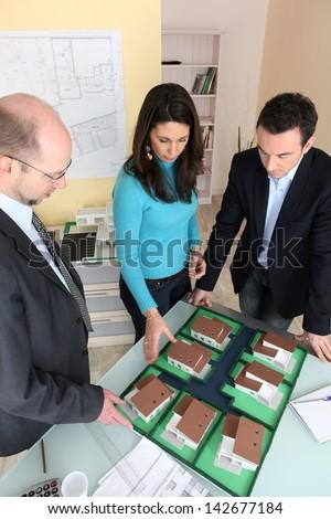 Architect with investors - stock photo