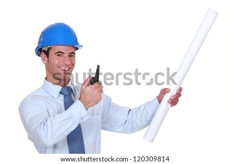 Architect with plans and blue-prints - stock photo