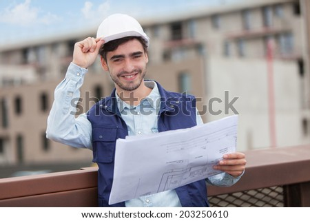 Architect woman and construction site supervisor watching plans