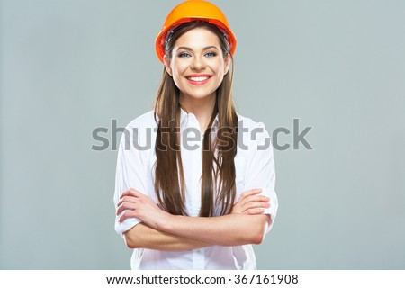 Architect woman isolated portrait with crossed arms. Woman wearing protect helmet.