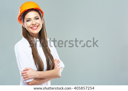 Architect woman isolated portrait with crossed arms. Woman wearing protect helmet. - stock photo