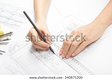Architect working on blueprint. Architects workplace - Architectural project, blueprints, drawings, sketch,plan, ruler, divider compass, pencil. Construction concept. Engineering tools. Top view