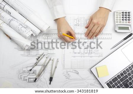 Architect working on blueprint architects workplace imagen de architect working on blueprint architects workplace architectural project blueprints ruler calculator malvernweather Gallery