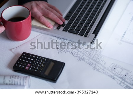 Architect working on blueprint. Architects workplace - architectural project, blueprints, ruler, calculator, laptop and divider compass. Construction concept. Engineering tools. Top view - stock photo
