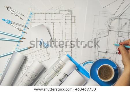 Architect working on blueprint architects workplace stock photo architect working on blueprint architects workplace architectural project blueprints ruler and divider malvernweather Gallery