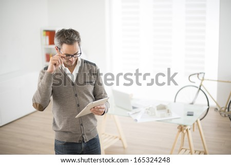 architect working  on digital tablet in his office - stock photo