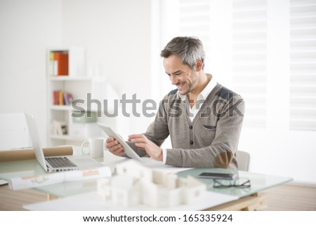 architect working on the office - stock photo