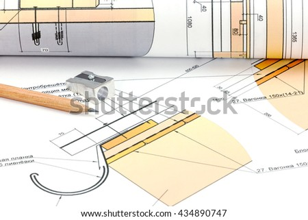 architect workspace with blueprint, rolls and pencil