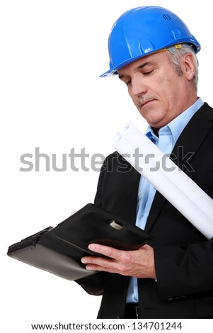 Architect writing in a diary - stock photo