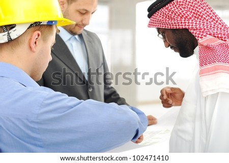 Architects at Middle east discussing engineering design project - stock photo