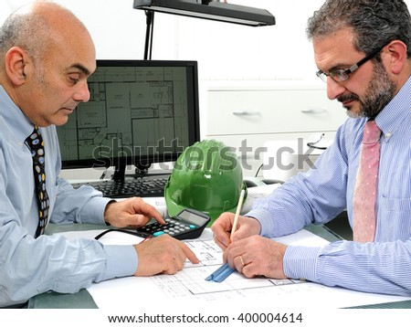 Architects at work in the office on a residential construction project. - stock photo
