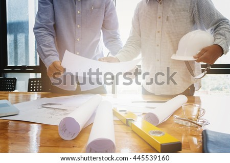 Architects concept, Architects working with blueprints in the office