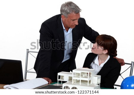 Architects discussing a  project - stock photo