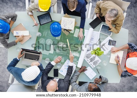 Architects Planning Around the Conference Table - stock photo