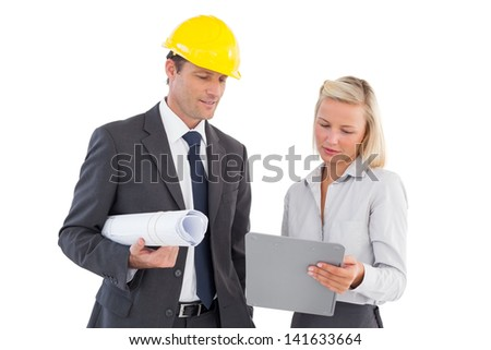Architects with hard and plans looking at clipboard on white background