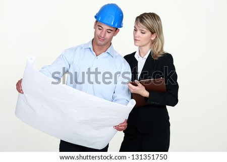 Architects with plans - stock photo