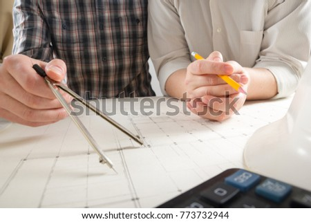 Architects working on blueprint, real estate project. Architect workplace - architectural project, blueprints, ruler, calculator, laptop and divider compass. Construction concept. Engineering tools.