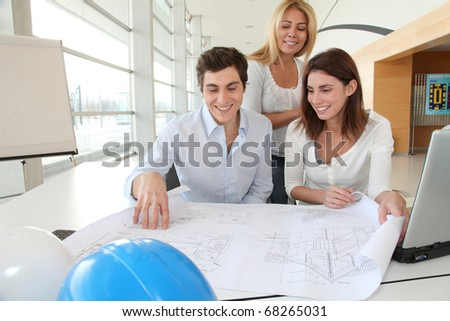 Architects working on construction project in the office - stock photo
