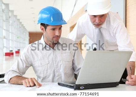 Architects working on planning - stock photo