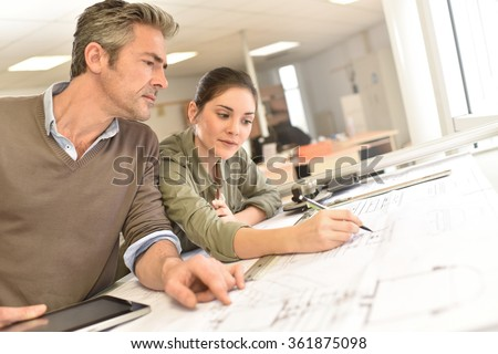 Architects working on project in office