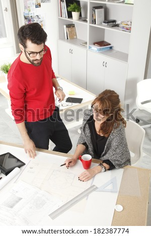 Architects working together in small architect studio.