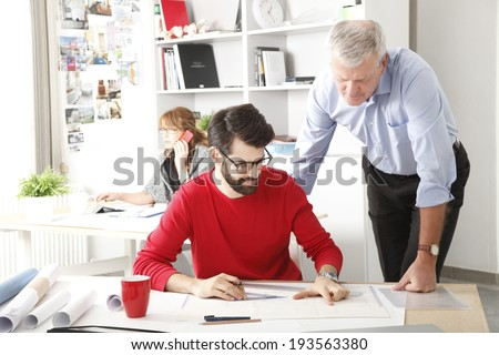 Architects working together in small architect studio. - stock photo