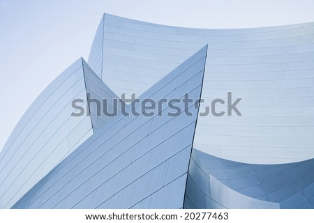 Architectural abstract of stainless steel walls. - stock photo