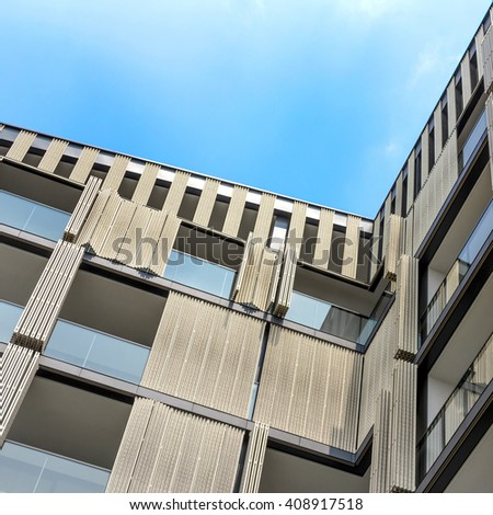 Architectural background of a modern apartments with wooden facade - stock photo