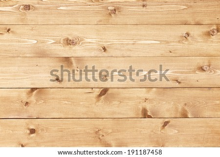 Architectural background texture of a panel of natural unpainted pine board cladding with knots and wood grain in a parallel pattern conceptual of woodwork, carpentry, joinery and construction - stock photo