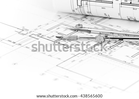 architectural background with plan, blueprint roll and drawing compass - stock photo